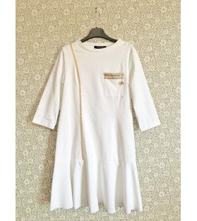 Vestito bianco con decorazioni catena